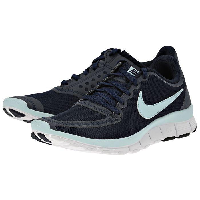 Nike  Free WMNS 511281400 ΜΠΛΕ ΣΚΟΥΡΟ Γυναικείο running αθλητικό υπόδημα από την Nike, συνδυάζει την άνεση στο τρέξιμο και την πρόληψη τραυματισμών. Είναι κατασκευασμένο από αναπν